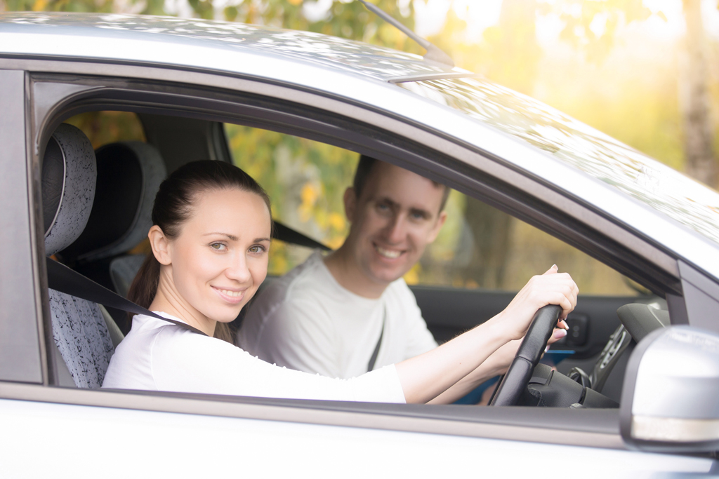 Photo of pupil in car with driving instructor