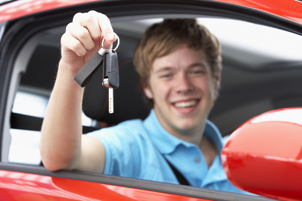 Photo of pupil in car holding car keys after passing test