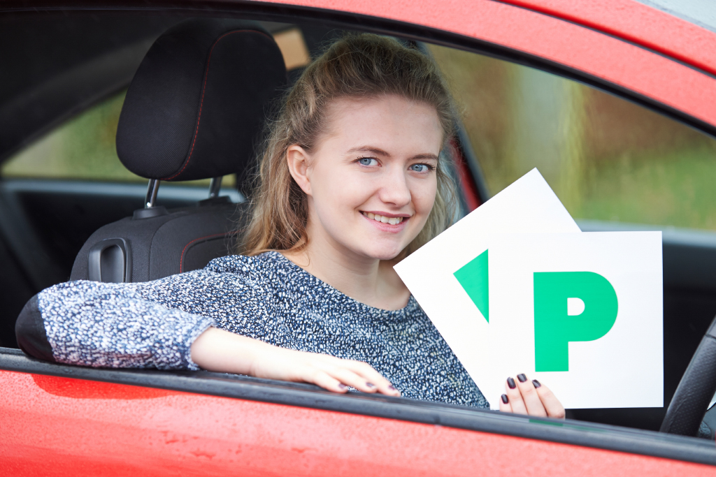 Photo of pupil in car holding P plates